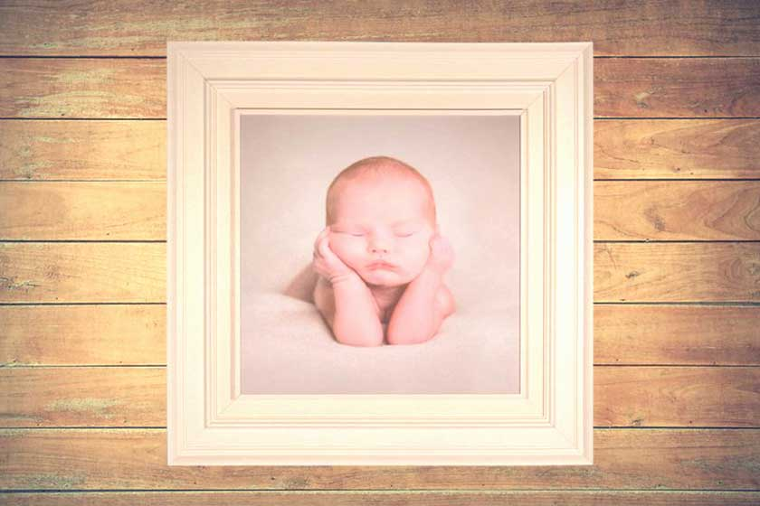photograph of baby in a frame